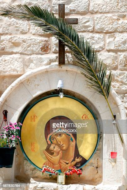 An Icon depicting the Virgin Mary holding the infant Jesus is seen in the yard of the Bethlehem Icon Center in the biblical West Bank city of...