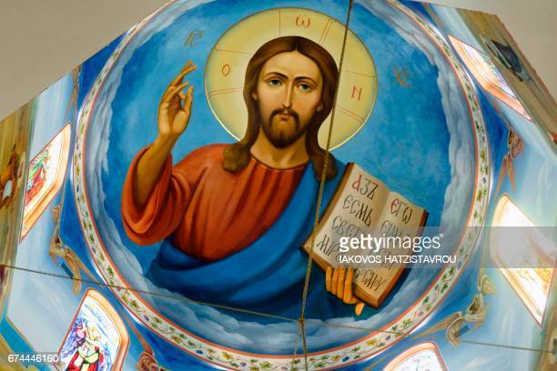 An icon of Jesus Christ is seen on the roof of a Russian Orthodox church in the village of Episkopio in the Cypriot district of Nicosia on April 28...