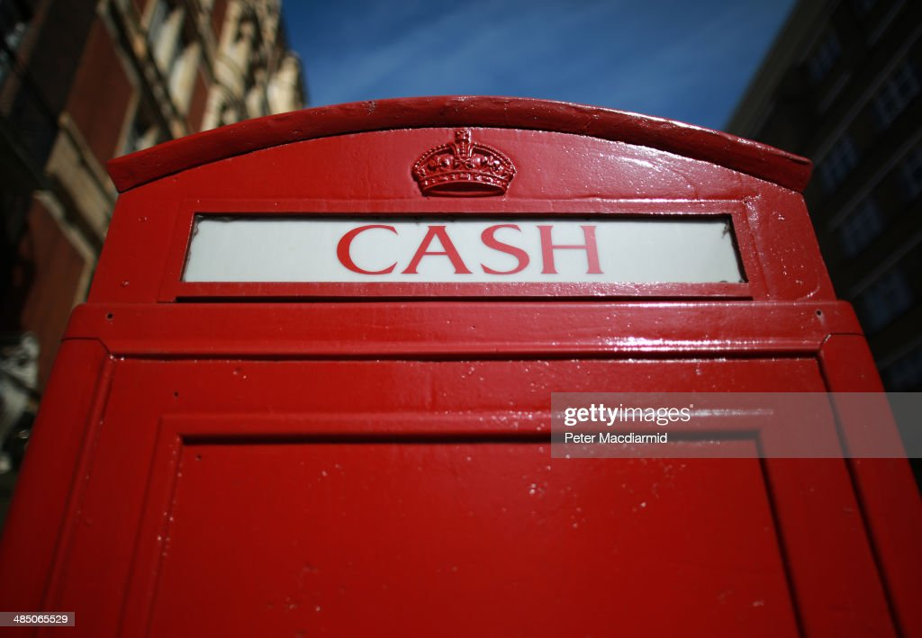 An iconic red telephone box has been turned in to a cash dispensing machine in Knightsbridge on April 16, 2014 in London, England. The capital continues to see growth and house price inflation is rising at a much faster rate than the rest of the United Kingdom.