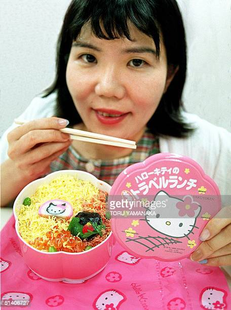 An identified woman is about to eat a boxed lunch showing 'Hello Kitty' popular character from creator Japan's Sanrio Co Ltd in Tokyo 23 August A...