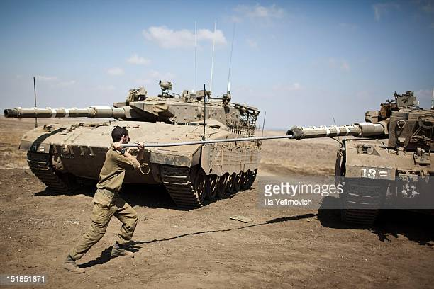An IDF soldier services a tank during 'The Efrat' exercise on September 12 2012 in the Golan Heights The exercise is used by the Aerial Supply Unit...