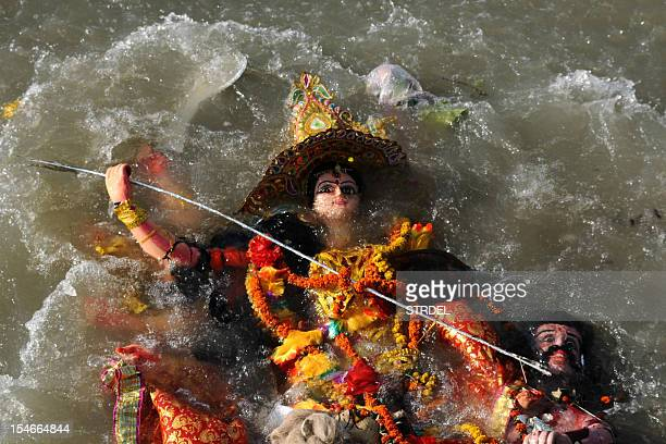 An idol of Hindu goddess Durga floats in the Brahmaputra river after immersion during the Vijaya Dashami or Dusshera Festival in Guwahati on October...