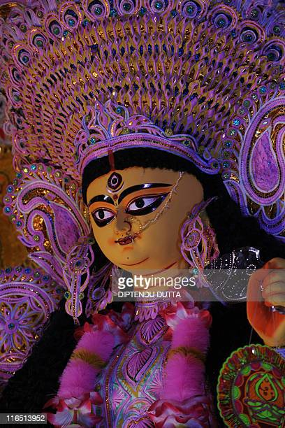An idol of the Hindu Goddess Durga is pictured during the Durga pooja festival in Siliguri on October 16 2010 The five day worship of Durga Puja...