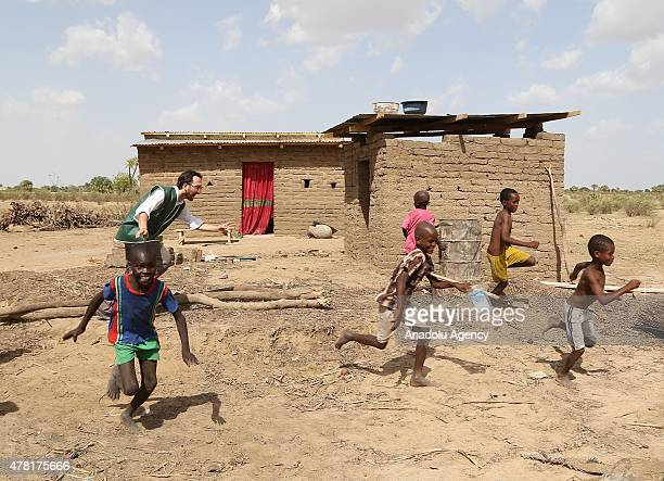 N'DJAMENA CHAD JUNE 22 An IHH volunteer plays with children in a village near the capital N'Djamena Chad on June 22 2015 Turkeys Humanitarian Relief...