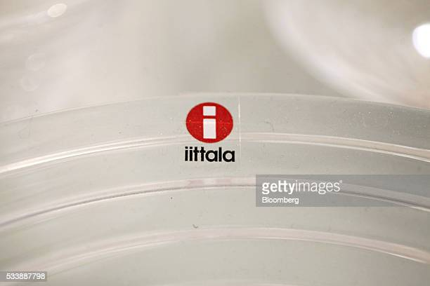 An Iittala Oyj logo sits on a glass product following manufacture at the Iittala Oyj glass factory operated by Fiskars Oyj in Hameenlinna Finland on...