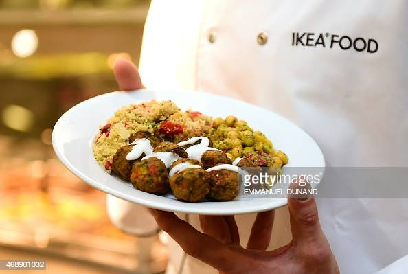 An IKEA employee displays the new IKEA vegetarian meatballs during a worldwide launch at IKEA Anderlecht on April 8 2015 IKEA who withdrew its...