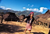 An Iko woman leaves the village of Sopee for the two day walk down the remote mountainside to Muang Sing in the North of Laos These hilltribe people...