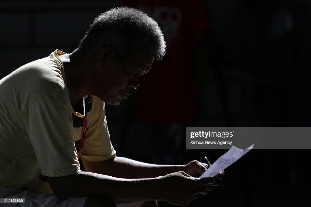 An illegal drug user reads his affidavit of surrender as he surrenders to authorities along with other drug addicts at Camp Karingal in Quezon City, the Philippines, June 24, 2016. Around 750 drug users and pushers surrendered to authorities during the Quezon City Police District's anti-drug campaign on Friday. The police operation aims to encourage drug addicts to surrender to authorities and pledge themselves to stop their activities involving illegal drugs.