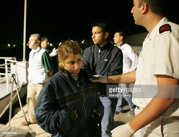 An illegal immigrant is sent to a temporary holding centre for foreign nationals on June 13 2005 in Lampedusa Italy Lampedusa Island in the...