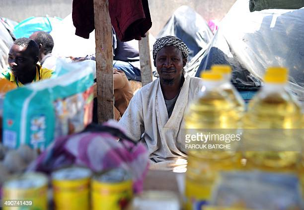 An Illegal migrant from Niger sells food items on May 14 2014 after he and other migrants settled some of them for more than one year near the fruit...