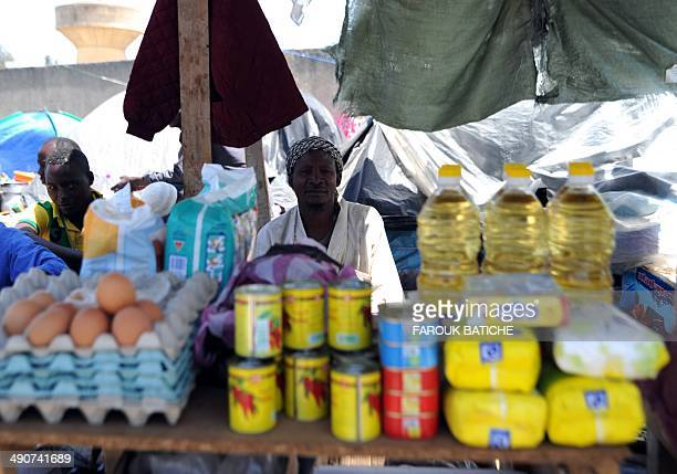 An illegal migrant from Niger sells food items on May 14 2014 after settling with other migrants some of them for more than one year near the fruit...