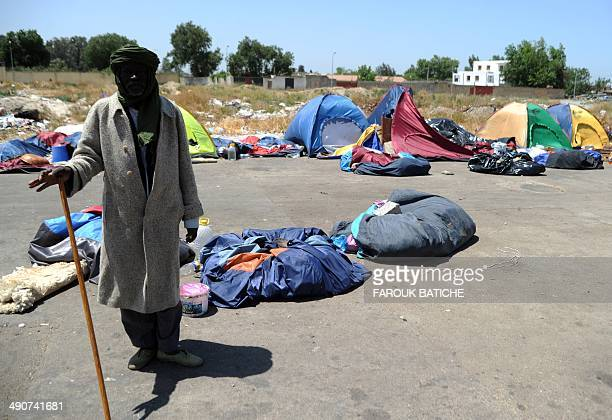 An illegal migrant from Niger stands next to tents on May 14 2014 after settling with other migrants some of them for more than one year near the...