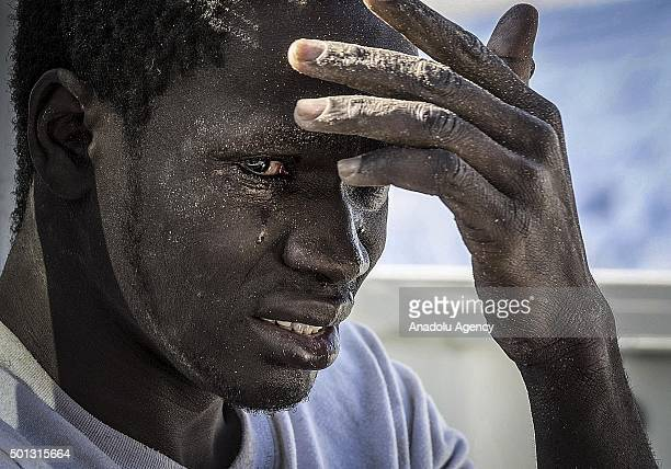 An illegal migrant reacts at the coast of Souq al Jum'aa region in Tripoli Libya after they got captured on March 13 2015 Total of 97 illegal...