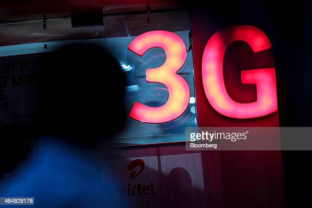 An illuminated '3G' sign is displayed outside a Bharti Airtel Ltd store in Mumbai India on Saturday Feb 28 2015 The government auction of telecom...