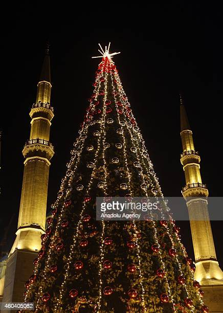 An illuminated Christmas tree is seen near the Mohammad AlAmin Mosque in in Byblos Lebanon on December 10 2014 Sculptures amusement parks Christmas...