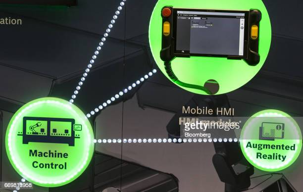 An illuminated connected industry 40 display sits inside the Robert Bosch GmbH digital factory in Stuttgart Germany on Tuesday April 18 2017 The...