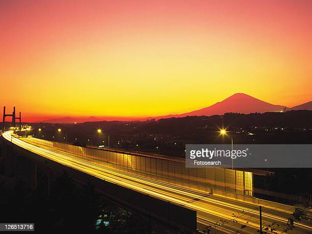 an Illuminated Highway By Sunset, the Mt. Fuji Red From the Colors of the Sun, Side View, Long Exposure, High Angle View, Shizuoka Prefecture, Japan