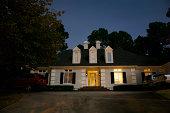 An illuminated house at night