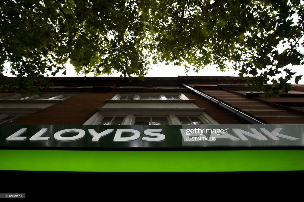 An illuminated Lloyds logo sits above the entrance to a branch of a Lloyds bank in central London on October 5 2015 Britain will sell another £20...