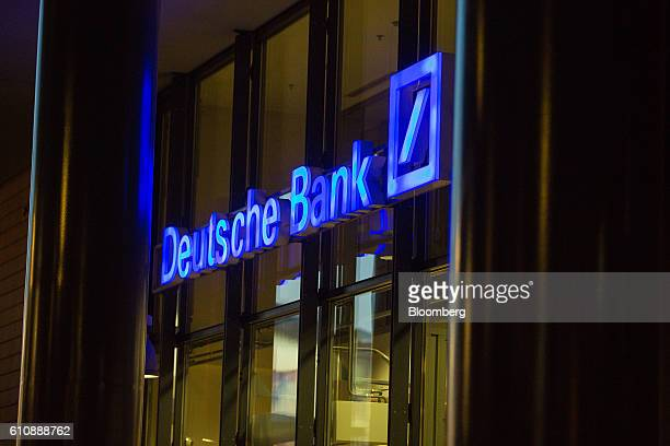 An illuminated logo for Deutsche Bank AG sits on the exterior of a bank branch in Berlin Germany on Wednesday Sept 28 2016 Deutsche Bank AG rose in...