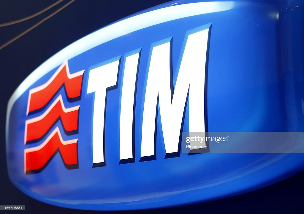 An illuminated logo is seen inside a TIM store, the mobile phone unit of Telecom Italia SpA in Rome, Italy, on Monday, April 15, 2013. Telecom Italia SpA, which received approval from its board to pursue a possible merger with Hutchison Whampoa Ltd.'s Italian business 3 Italia, said billionaire Li Ka-shing's company would want control of any combined entity. Photographer Alessia Pierdomenico/Bloomberg via Getty Images