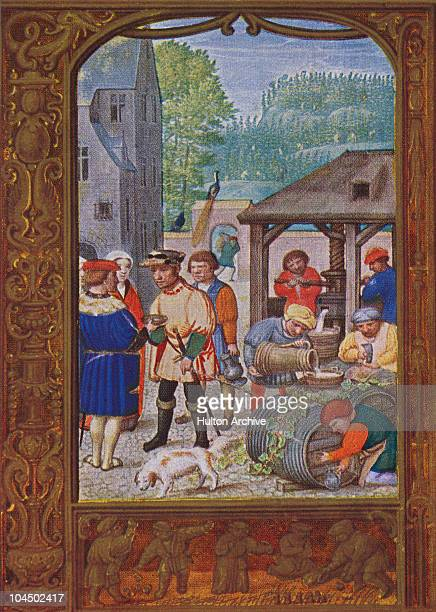 An illuminated manuscript depicts Flemish people pouring out the new vintage early 16th century In the border others play skittles with knucklebones