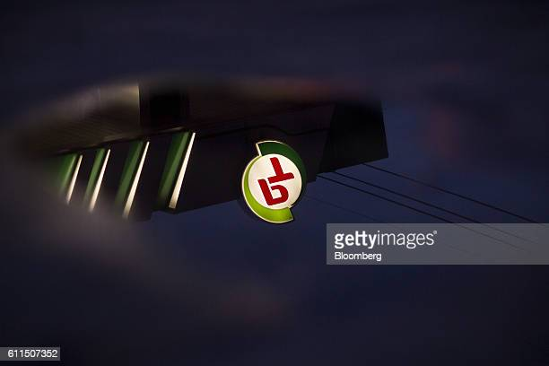 An illuminated PTG Energy Pcl logo atop a gas station is reflected in a puddle in Bangkok Thailand on Thursday Sept 29 2016 PTG is poised to take the...
