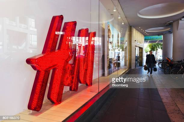An illuminated red logo sits in the window of a Hennes Mauritz AB fashion store in Stockholm Sweden on Wednesday June 28 2017 Costcontrol is the new...