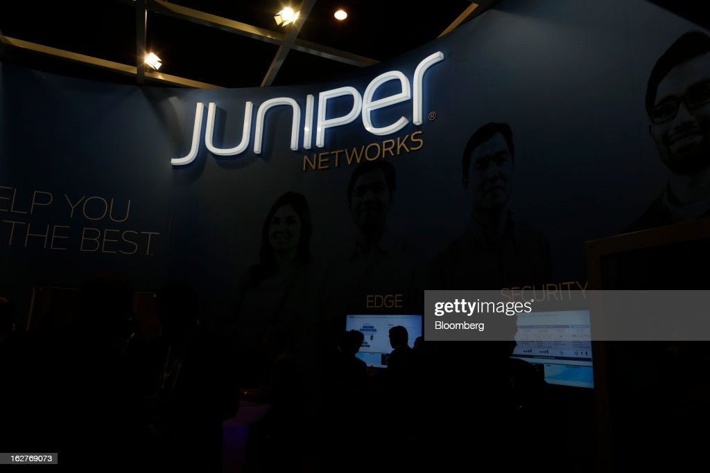 An illuminated sign hangs above the Juniper Networks Inc. pavilion at the Mobile World Congress in Barcelona, Spain, on Tuesday, Feb. 26, 2013. The Mobile World Congress, where 1,500 exhibitors converge to discuss the future of wireless communication, is a global showcase for the mobile technology industry and runs from Feb. 25 through Feb. 28. Photographer: Simon Dawson/Bloomberg via Getty Images