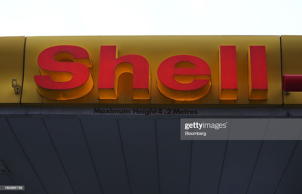 An illuminated sign is seen above the entrance to a Royal Dutch Shell Plc. petrol station in London, U.K., on Tuesday, Jan. 29, 2013. Oil traded near the highest level in four months ahead of a Federal Reserve policy statement that may signal the U.S. central bank will take additional steps to stimulate the economy. Photographer: Chris Ratcliffe/Bloomberg via Getty Images