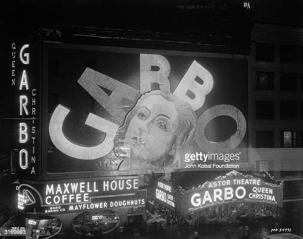 An illuminated sign outside the Astor Theatre in New York advertising the Swedish born American actress Greta Garbo's latest film 'Queen Christina'