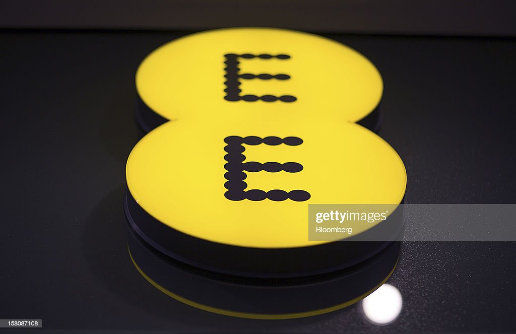 An illuminated sign sits above the entrance to a EE (Everything Everywhere) store, a joint venture between France Telecom SA and Deutsche Telekom AG, in Stratford, U.K., on Monday, Dec. 5, 2012. France Telecom CEO Stephane Richard said in an interview last month that the Paris-based company has received interest from private-equity firms seeking a minority stake in the 50-50 venture, and may also consider an initial public offering of the unit. Photographer: Jason Alden/Bloomberg via Getty Images
