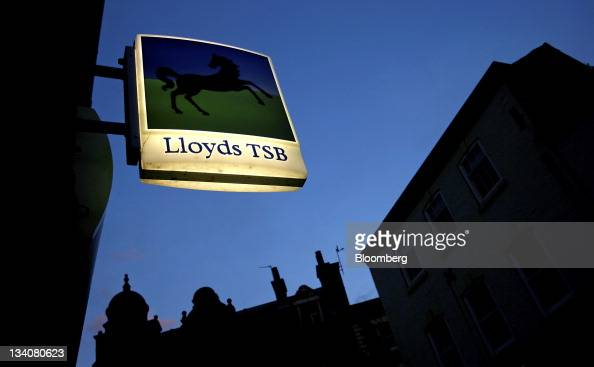 An illuminated sign sits outside a Lloyds TSB bank part of the Lloyds Banking Group Plc in Stockport UK on Thursday Nov 24 2011 Lloyds Banking Group...