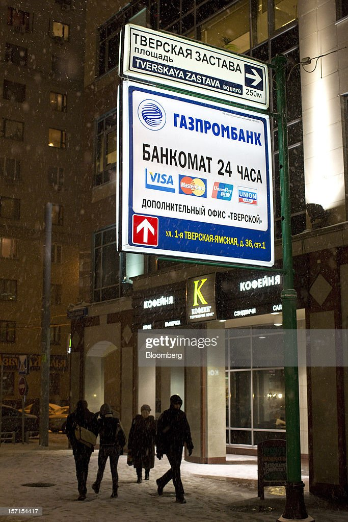An illuminated street sign indicates the location of an OAO Gazprombank in Moscow, Russia, on Wednesday, Nov. 28, 2012. Bank Rossii proposes government create rule limiting increases of budget funds held at central bank, RIA Novosti reports, citing First Deputy Chairman Alexey Ulyukayev. Photographer: Andrey Rudakov/Bloomberg via Getty Images