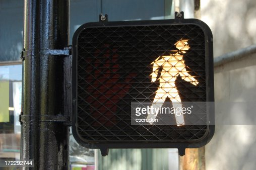 An illuminated walk street sign