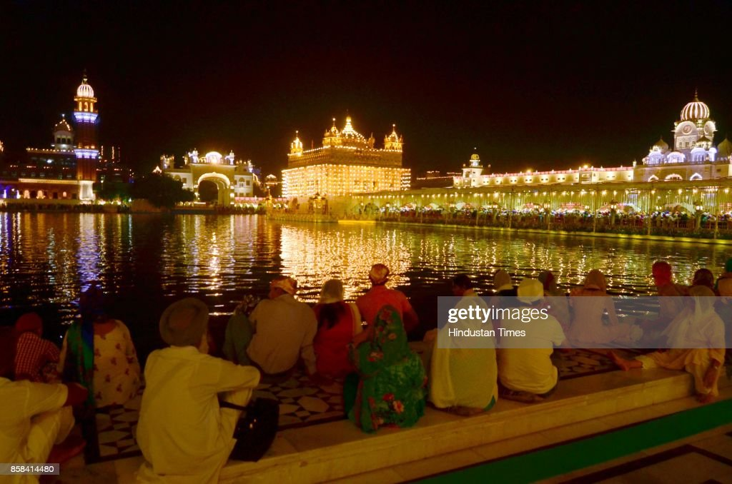 An illuminated with new LED lights Golden Temple reflecting divine view in combination with moon on the eve of birth anniversary of Guru Ram Das, Founder of the holy city, Amritsar, on October 6, 2017 in Amritsar, India.