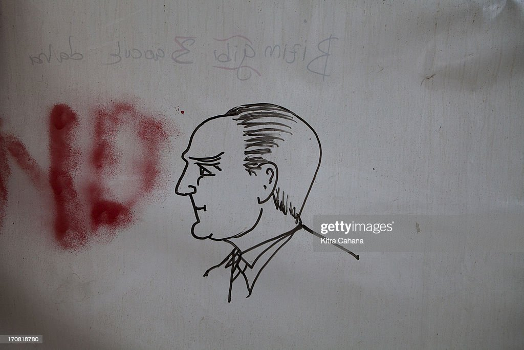 An illustrated portrait of Turkish Prime Minister Recep Tayyip Erdogan is seen on a wallin Gezi Park on June 15, 2013 in Istanbul, Turkey.