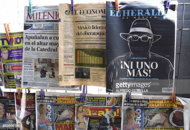 An illustration allusive to Mexican journalist Javier Valdez murdered on the eve is on the front page of El Heraldo Mexican newspaper in a news stall...