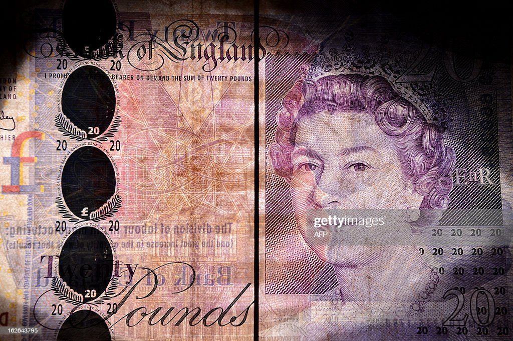 An illustrative picture backlit using a flashgun in London on February 25, 2013 shows a British 20 pound bank note. Moody's stripped Britain of its triple-A debt rating after markets closed on February 22, 2013, saying government debt was still mounting and that growth was too weak to reverse the trend before 2016 -- heaping more pressure on the pound. After hitting a fresh low-point on February 22, the pound recovered in trading in London to reach 1.5143 USD on February 25, compared with 1.5162 USD on February 22.