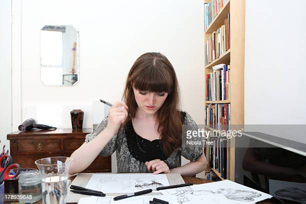 An illustrator working at home on illustrations