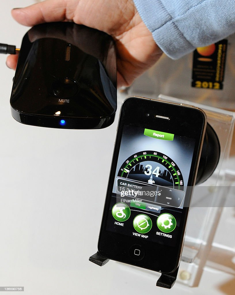 An image from Cobra's iRadar radar detection system is displayed on an Apple iPhone during a press event at The Venetian for the 2012 International Consumer Electronics Show (CES) January 8, 2012 in Las Vegas, Nevada. The iRadar uses Bluetooth to enable the user to see radar alerts and be warned of upcoming speed and red light cameras and now the information is community based. The information uploads to Cobra's cloud and is relayed back to drivers in the user's area. The hardware component (L) is available for USD 129 and is used with a free phone application. CES, the world's largest annual consumer technology trade show, runs from January 10-13 and is expected to feature 2,700 exhibitors showing off their latest products and services to about 140,000 attendees.