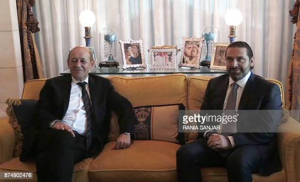 TOPSHOT An image grab from an AFP TV shows French Foreign Minister JeanYves Le Drian during a meeting with Lebanese Prime Minister Saad Hariri at the...