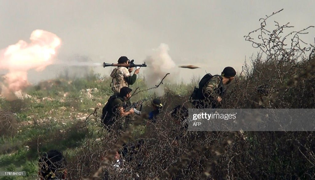 An image grab taken from a video shows an opposition fighter firing an rocket propelled grenade on August 26 2013 during clashes with regime forces...