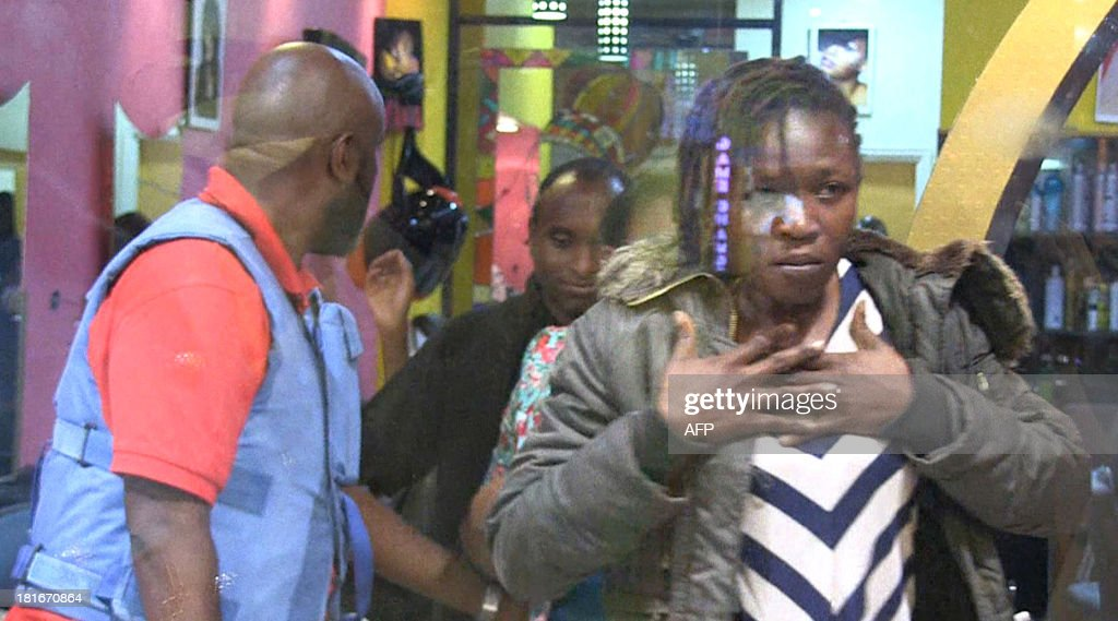 An image grab taken from AFP TV shows civilians being evacuated from a shopping mall following an attack by masked gunmen in Nairobi on September 21, 2013. Masked attackers stormed the packed upmarket shopping mall in Nairobi, spraying gunfire and killing at least 59 people and wounding 175 before holing themselves up in the complex. AFP PHOTO/AFPTV/NICHOLE SOBECKI