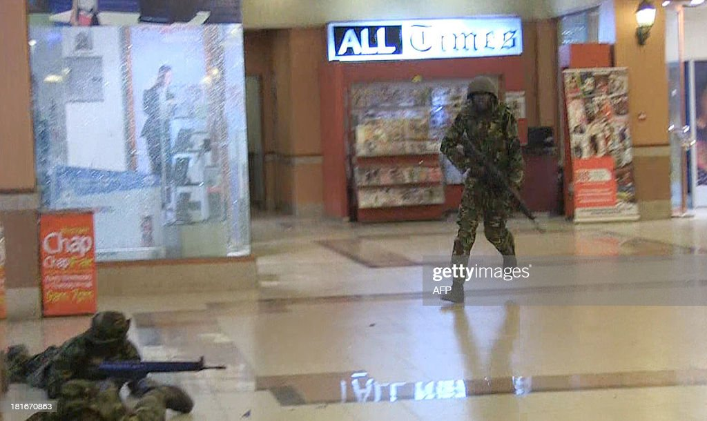 An image grab taken from AFP TV shows Kenyan troops taking position on September 21, 2013 inside the Westgate mall in Nairobi. Kenyan troops were locked in a fierce firefight with Somali militants inside an upmarket Nairobi shopping mall on September 22 in a final push to end a siege that has left at least 59 dead and some 200 wounded with an unknown number of hostages still being held. Somalia's Al Qaeda-inspired Shebab rebels said the carnage at the part Israeli-owned complex mall was in retaliation for Kenya's military intervention in Somalia, where African Union troops are battling the Islamists. AFP PHOTO/AFPTV/NICHOLE SOBECKI