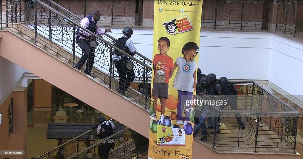 An image grab taken from AFP TV shows Kenyan troops taking position on September 21 2013 inside the Westgate mall in Nairobi Kenyan troops were...