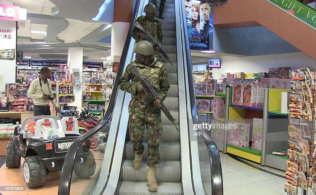 An image grab taken from AFP TV shows military forces taking position inside a shopping mall following an attack by masked gunmen in Nairobi on September 21, 2013. Masked attackers stormed the packed upmarket shopping mall in Nairobi, spraying gunfire and killing at least 59 people and wounding 175 before holing themselves up in the complex.