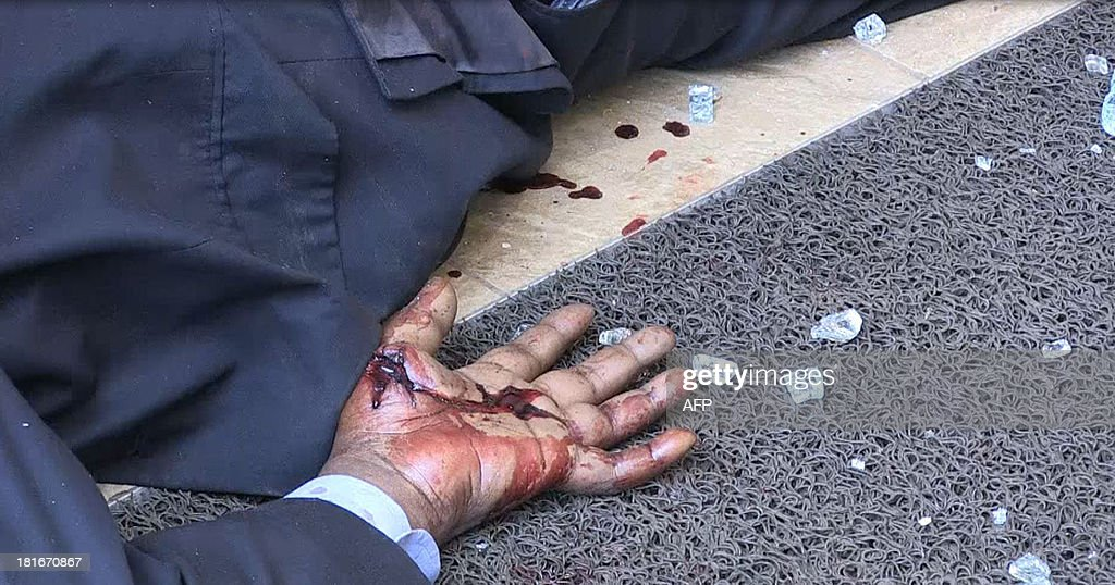 An image grab taken from AFP TV shows the bloodied hand of a victim lying on the ground on September 21 2013 inside the Westgate mall in Nairobi...