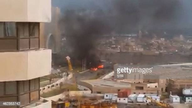 An image grab taken from an AFPTV video shows fire and smoke rising in front of the Corinthia hotel in Tripoli on January 27 2015 after gunmen...