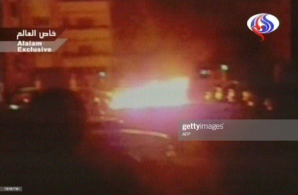 An image grab taken from footage broadcast on February 15 2008 on the Iranian Arabicspeaking AlAlam TV shows flames rising from the site of a car...